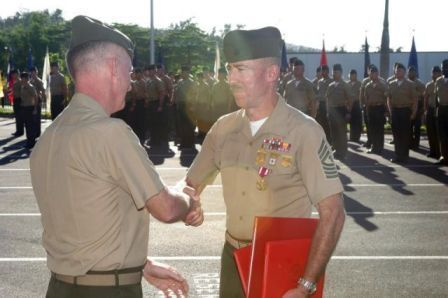 Commanding General congratulating me after pinning on Meritorious Service medal and retirement certificates.